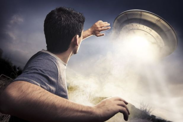 man-running-from-ufo