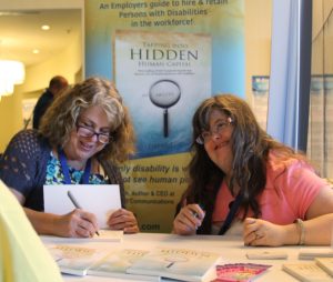Debra and Sara Signing Books