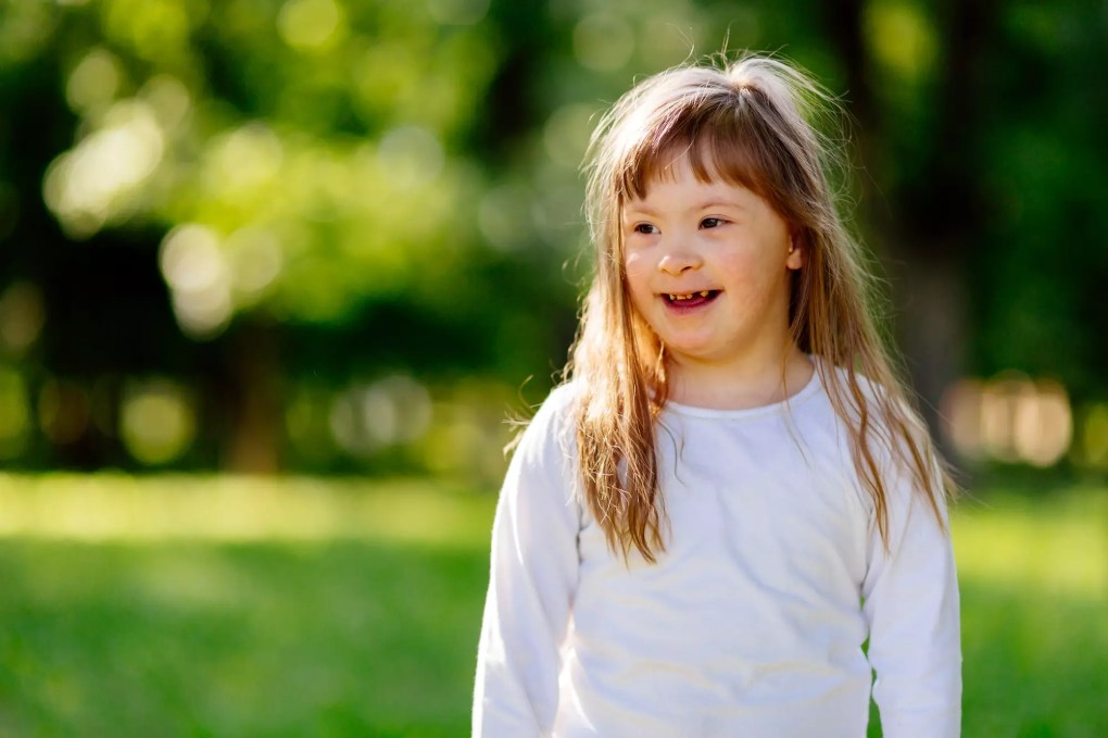 Beautiful happy child smiling outdoors