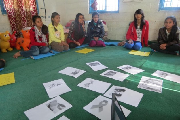 Bahini giving thoughts on displayed pictures