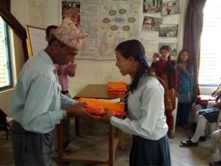 Rukmini Scholars accept their new school materials.