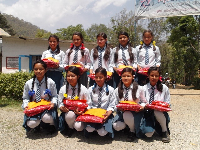 The first class of Rukmini Foundation pose with their new school materials