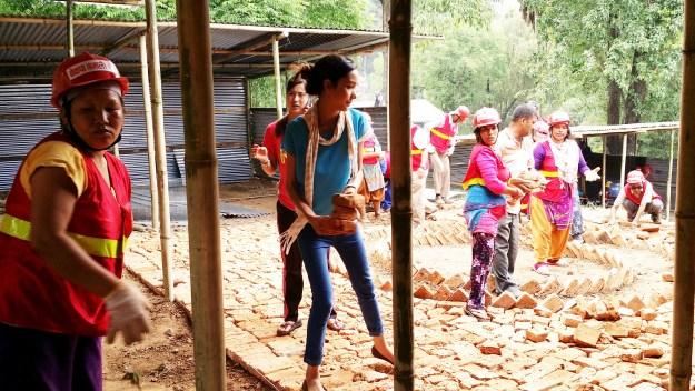 School teachers also gather to help