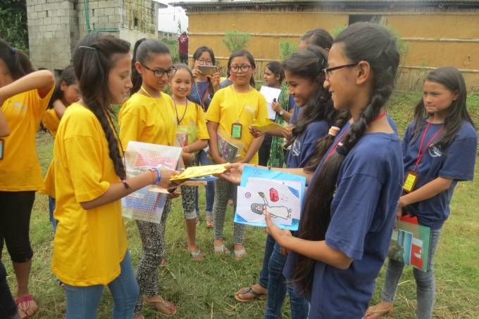 Litclub of Bhaktapur(in blue) sharing gifts with Litclub of Sikharapur(in yellow)
