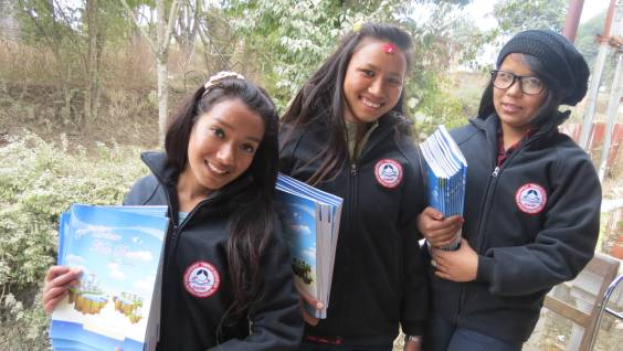 Bimala, Manisha and Junu (left to right) showing their new stationary and jackets