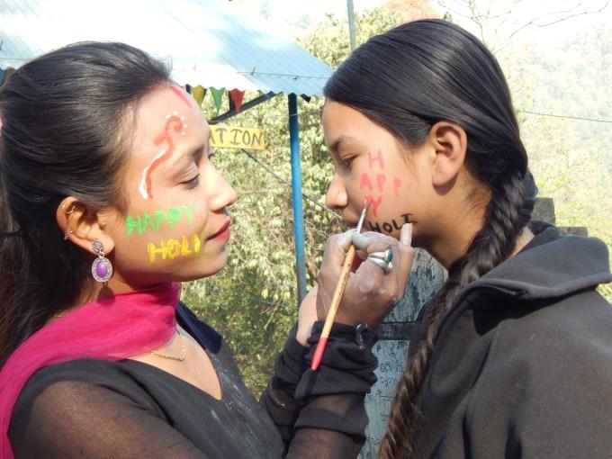 Didi Pramila paints Bahini Sadikshya KC's face