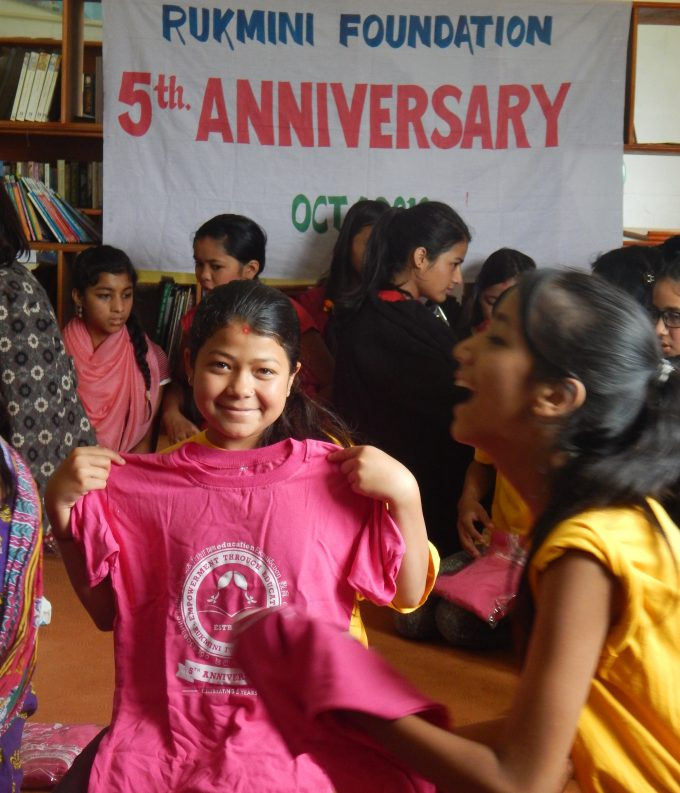 scholar-divya-kc-checks-her-tshirt-size-with-great-smile-in-her-face