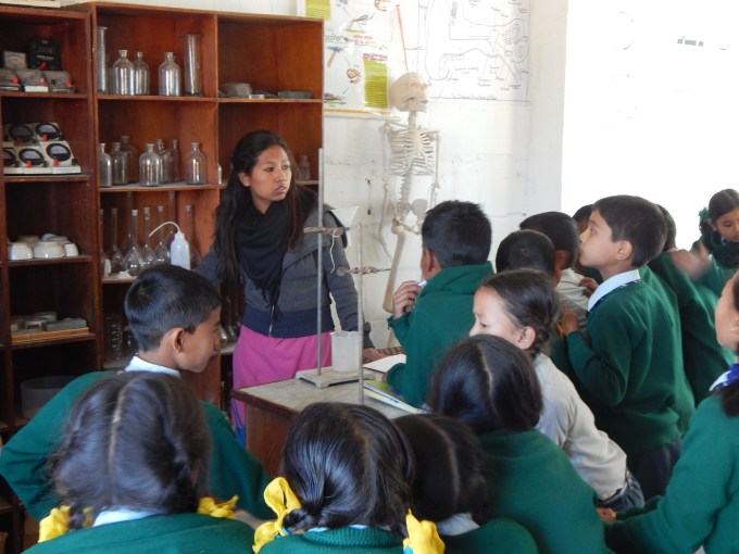 students-observing-science-lab