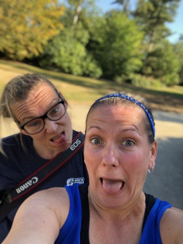 Two women pulling funny faces after running.