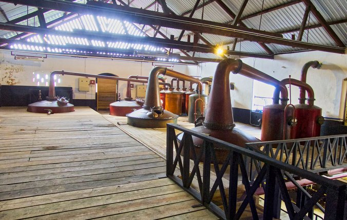 Caribbean Rum Cruise - The classic copper pot stills at Mount Gay distillery in Barbados