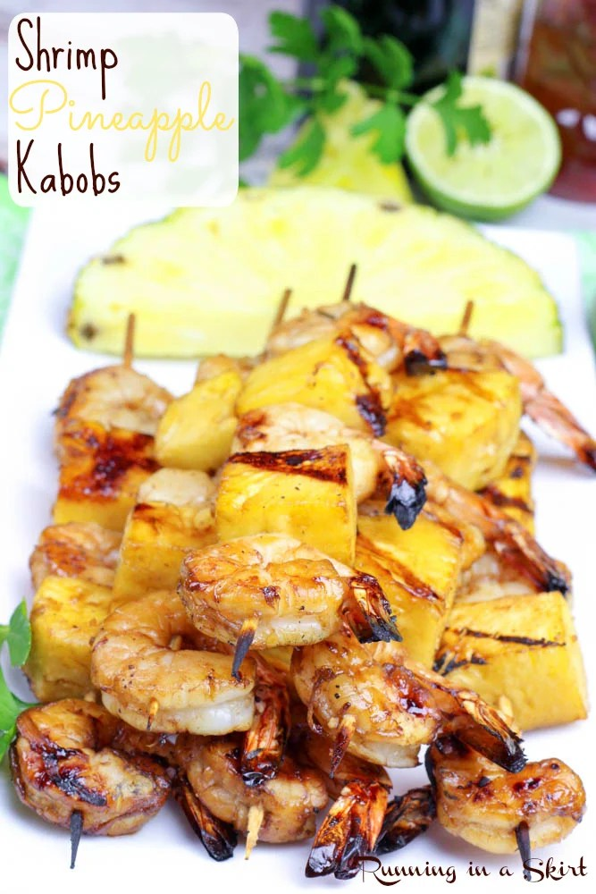 Shrimp Pineapple Kabobs on plate with pineapple in the background.