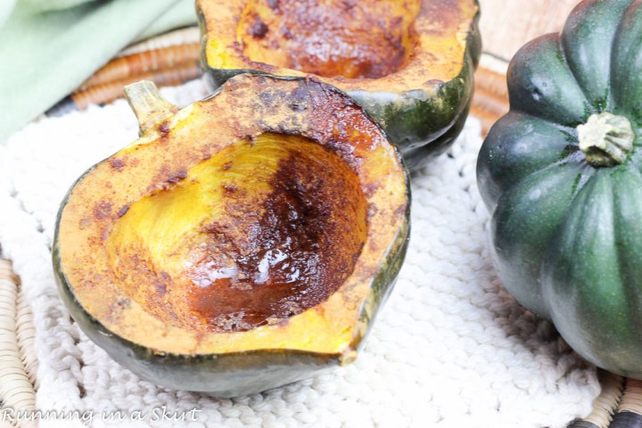Easy Healthy Baked Acorn Squash halves on a white plate after roasting.