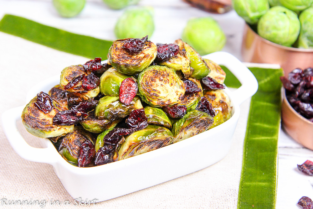 Maple Balsamic Brussels Sprouts and Cranberries in a white serving dish.