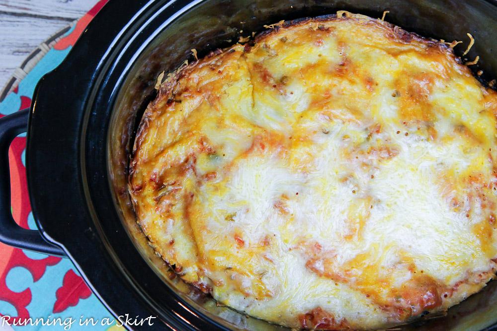 Crock Pot Vegetarian Enchilada Casserole in a black Crock Pot liner.