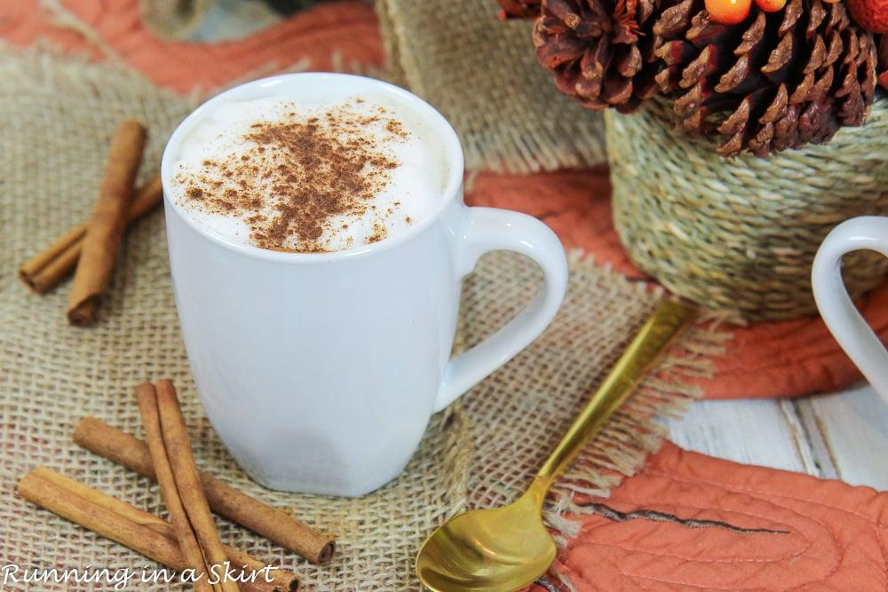 White mug with dirty chai latte.