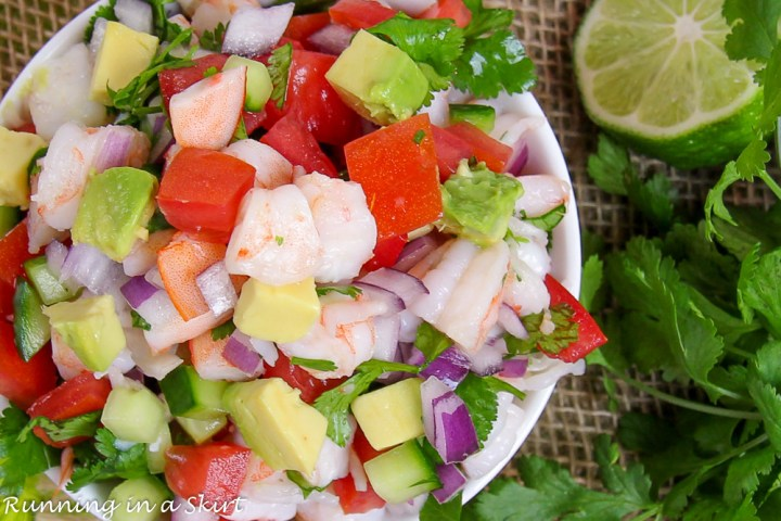 Overhead shop with shrimp, tomato, lime, avocado and onion