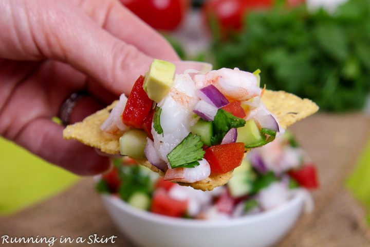 Seafood Salsa recipe on a chip with a hand.