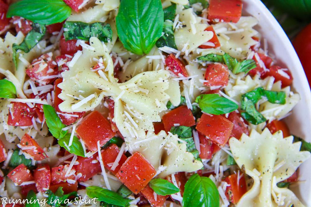 Pasta, tomato, cheese and basil.