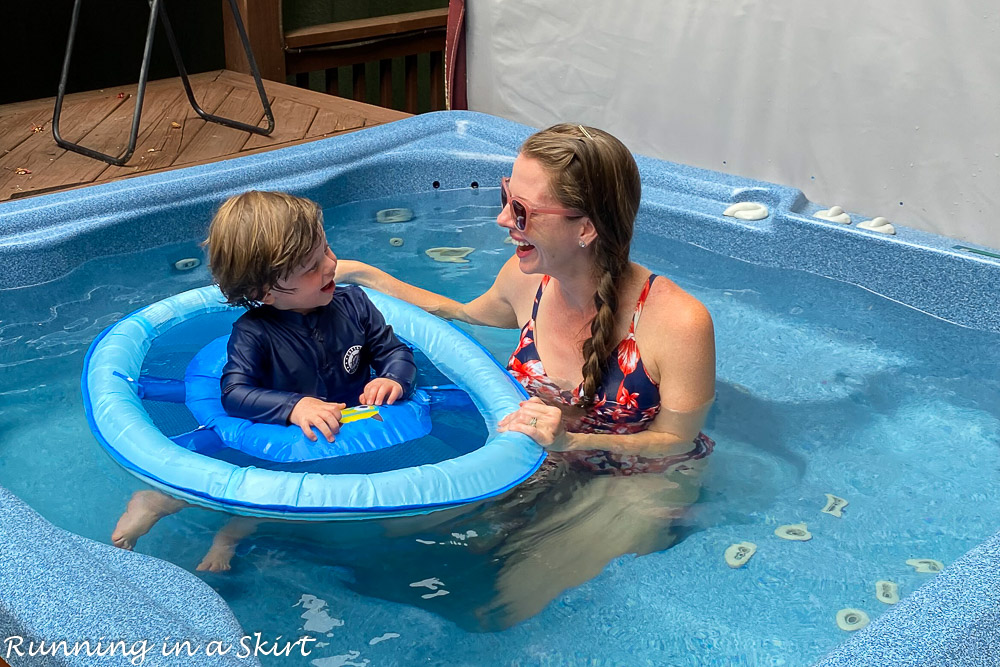Mom in pool with toddler.