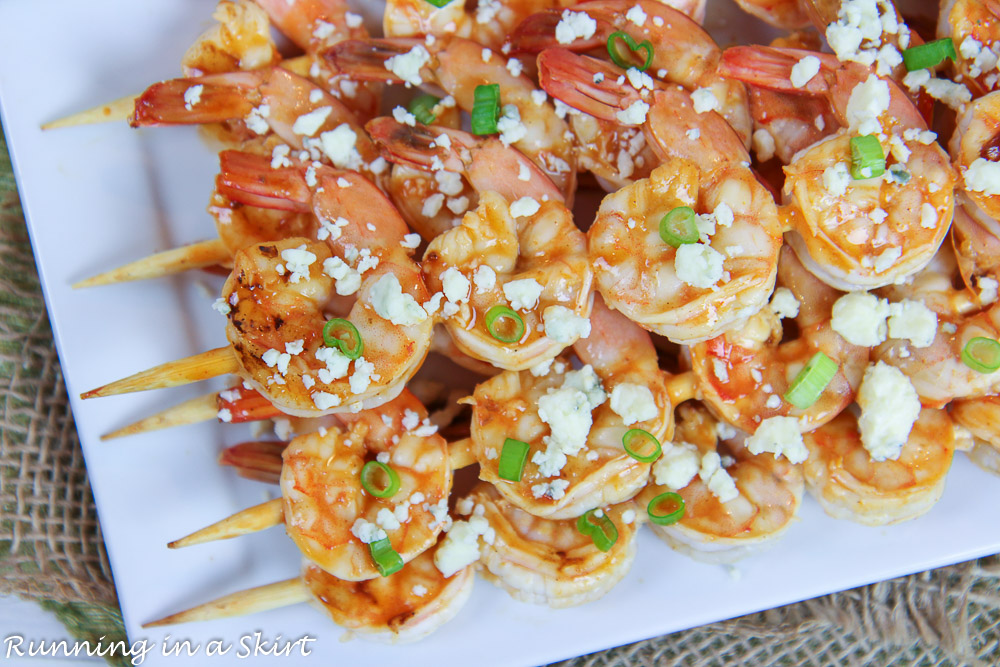 Grilled Buffalo Shrimp topped with blue cheese and green onion.
