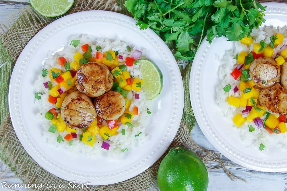 Finished product on plate of Seared Scallops with Mango Salsa on two white plates.