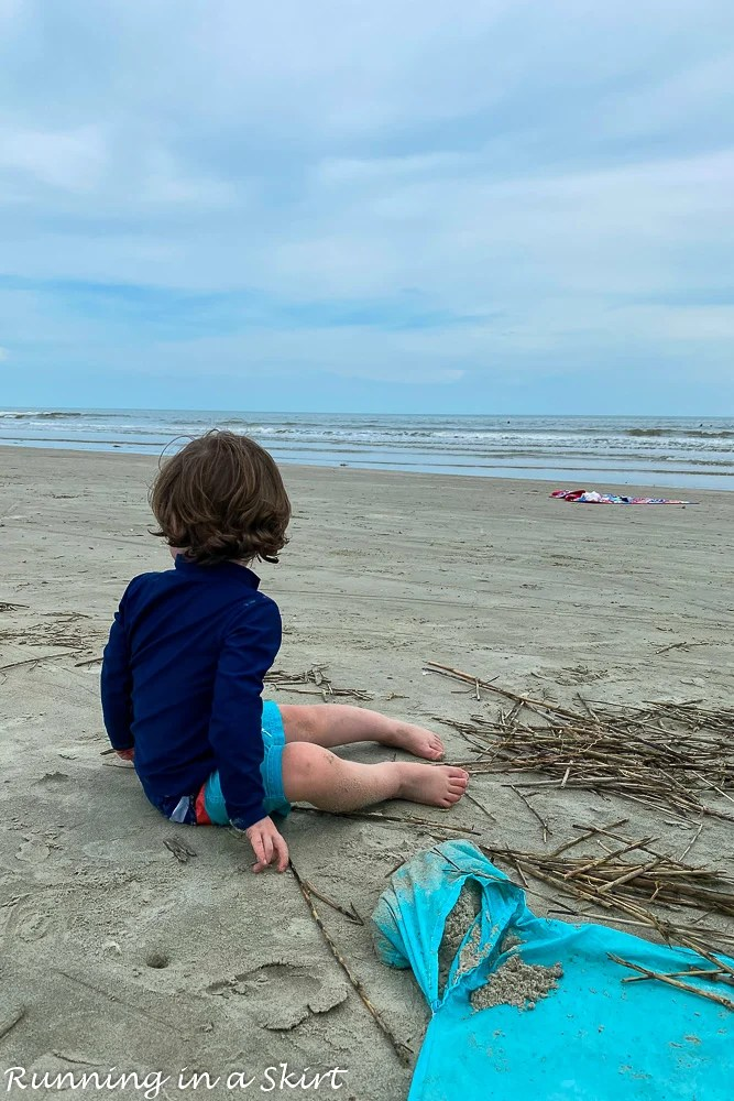 Toddler sitting in sand on Kiawah Island beaches.
