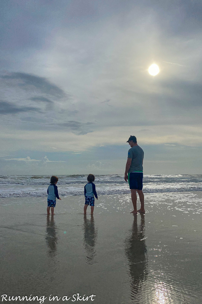 Dad with twins on Amelia Island beach.