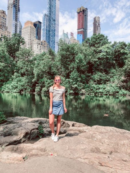 What to do in NYC in the summer when you've already been there   Get lost in Central Park, girl stands on central park bridge   summer outfit