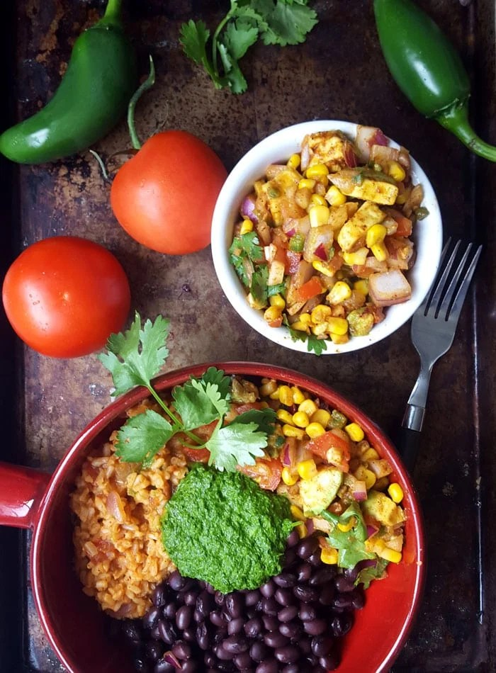 Vegan Burrito Bowls with Chimmichurri Sauce and Avocado Corn Salsa