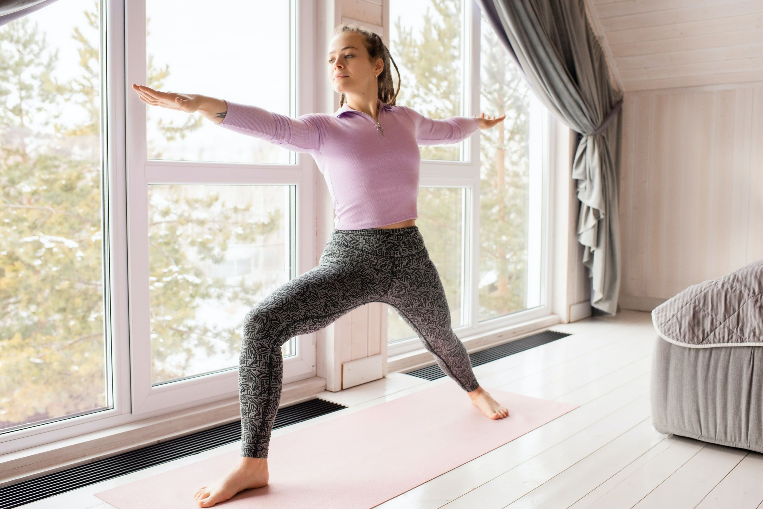 woman near a window working out at home