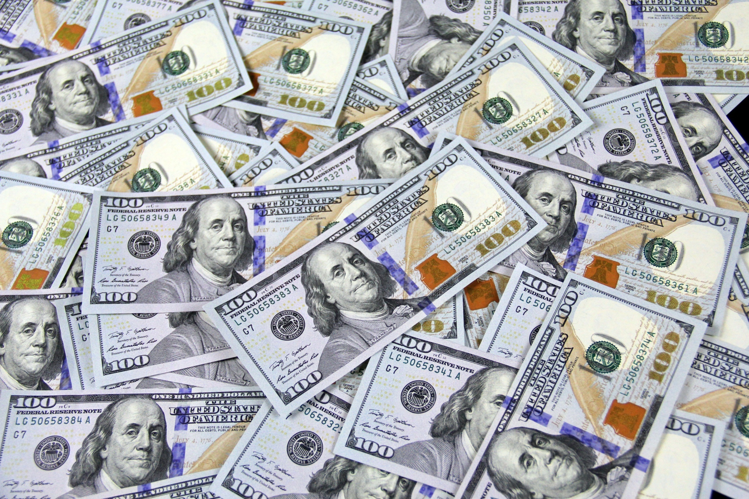 tons of 100 dollar bills - Get The Money You Need For A New Business