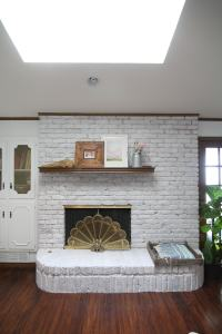 How to Whitewash a Brick Fireplace - Run To Radiance
