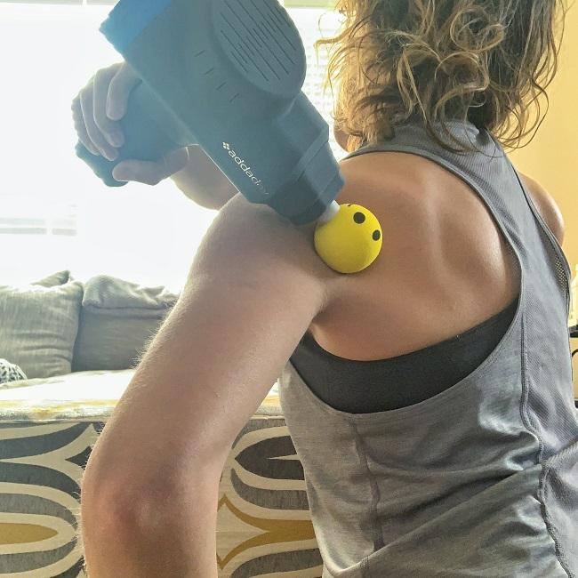 pistolet de massage épaules