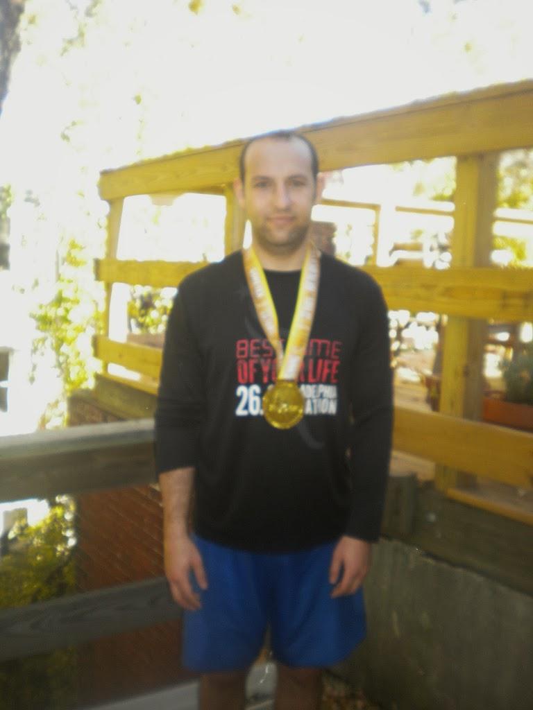 Bret's HUGE marathon medal - 3:41 time!