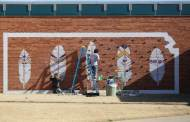 Couple make mural, and climbing wall for Medicine Lodge