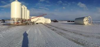 Farmers cleaning up after wind storm rips through central and northern Alberta
