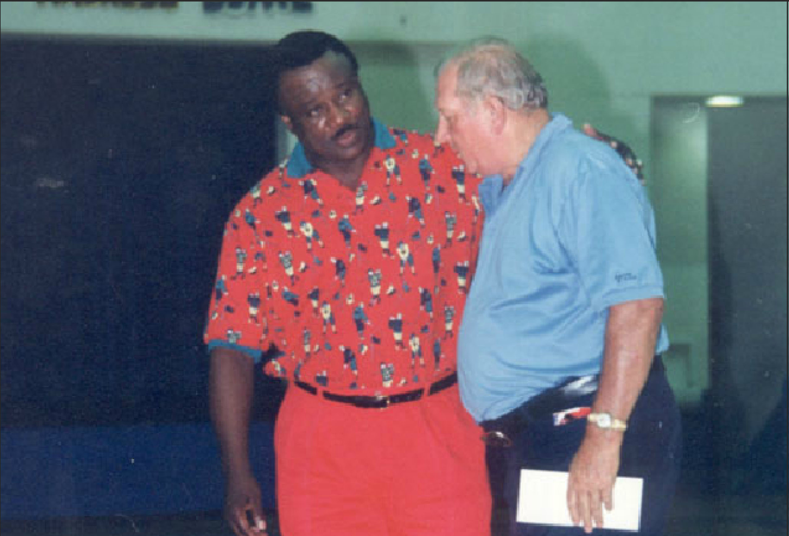 Richardson talking with his mentor, Don Haskins, in the late 1980s.