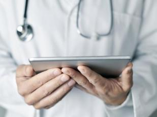 doctor using a tablet for a virtual patient visit