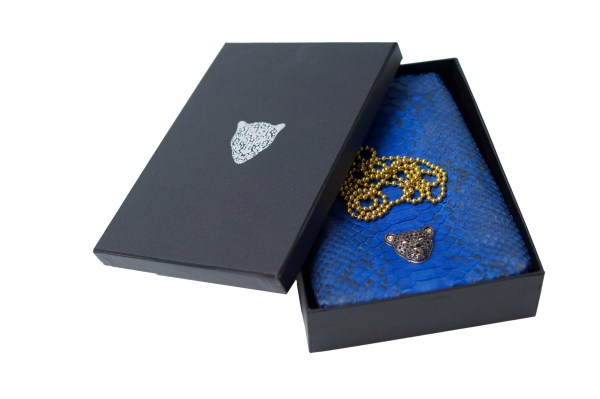 Blue Capsule Clutch with black logo RusiDesigns