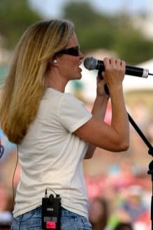 Kristi singing to the crowd