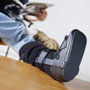 leg in cast man with pain in back Riverside Personal Injury Lawyer