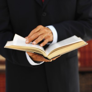 Personal Injury Attorney in Orange County holding law book