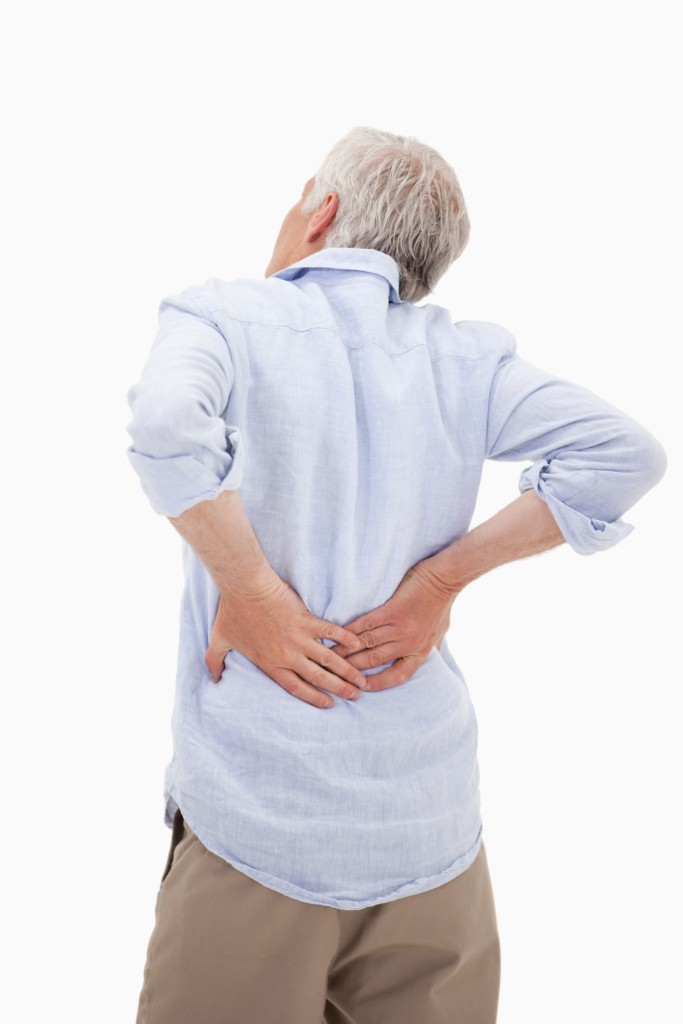 Portrait of a man having a back pain Riverside Car Accident Lawyers