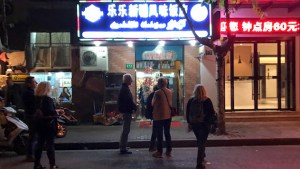 Walking down block of tiny bars and cafes