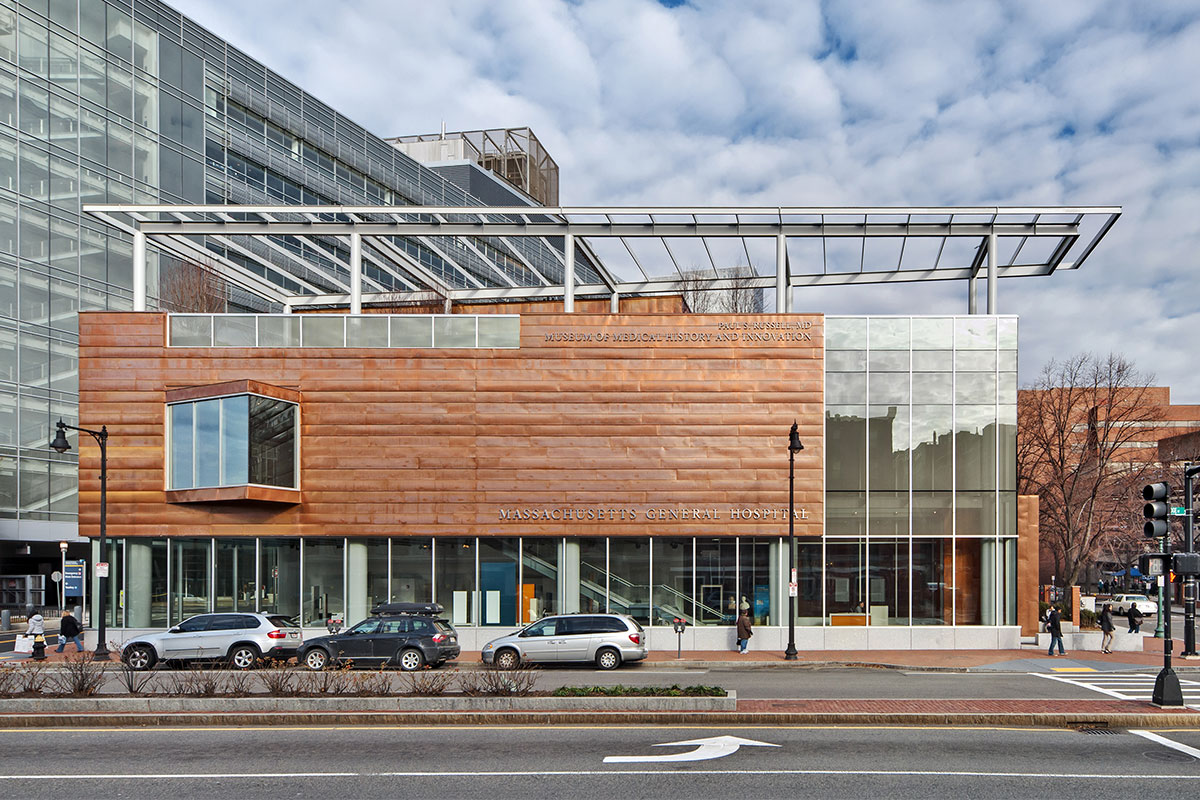Exterior street view of copper and glass MGH museum building in day