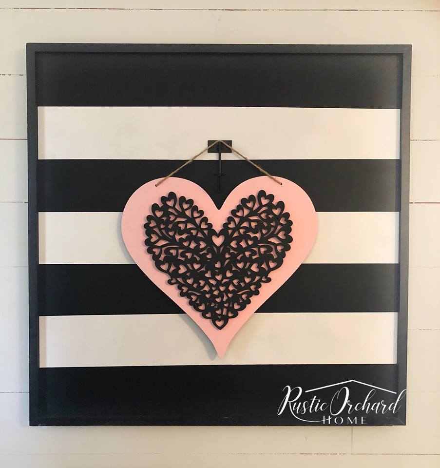 This DIY Valentine's Day Door Hanger is so easy to make & costs less than $10! Grab a full tutorial on the blog! #rusticorchardhome #valentinesday #diyvalentinesdaydecor #valentinesdaycraft
