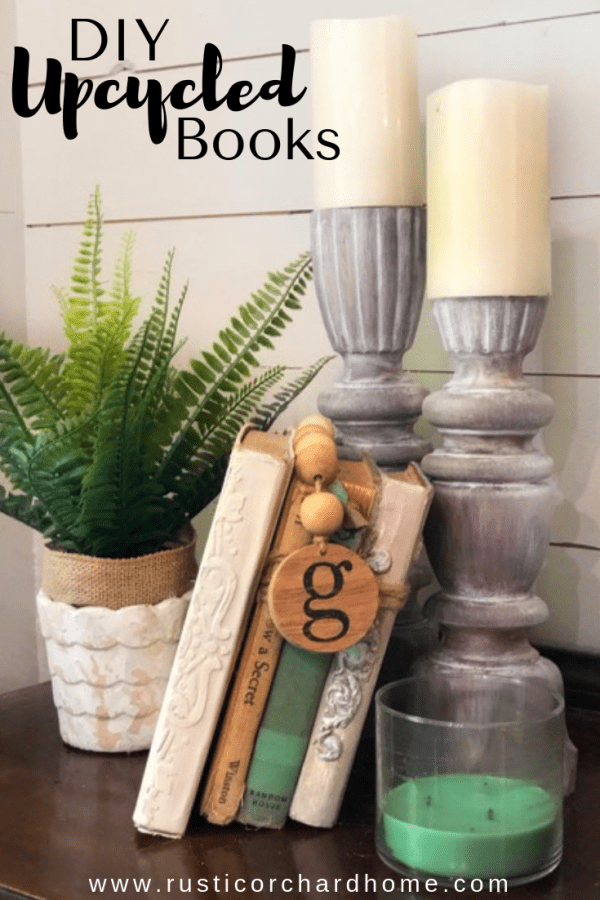 Upcycled Books that have been painted and embellished make great budget friendly home decor! #rusticorchardhome #upcycledbooks #paintedbooks #diyhomedecor #upcycledhomedecor