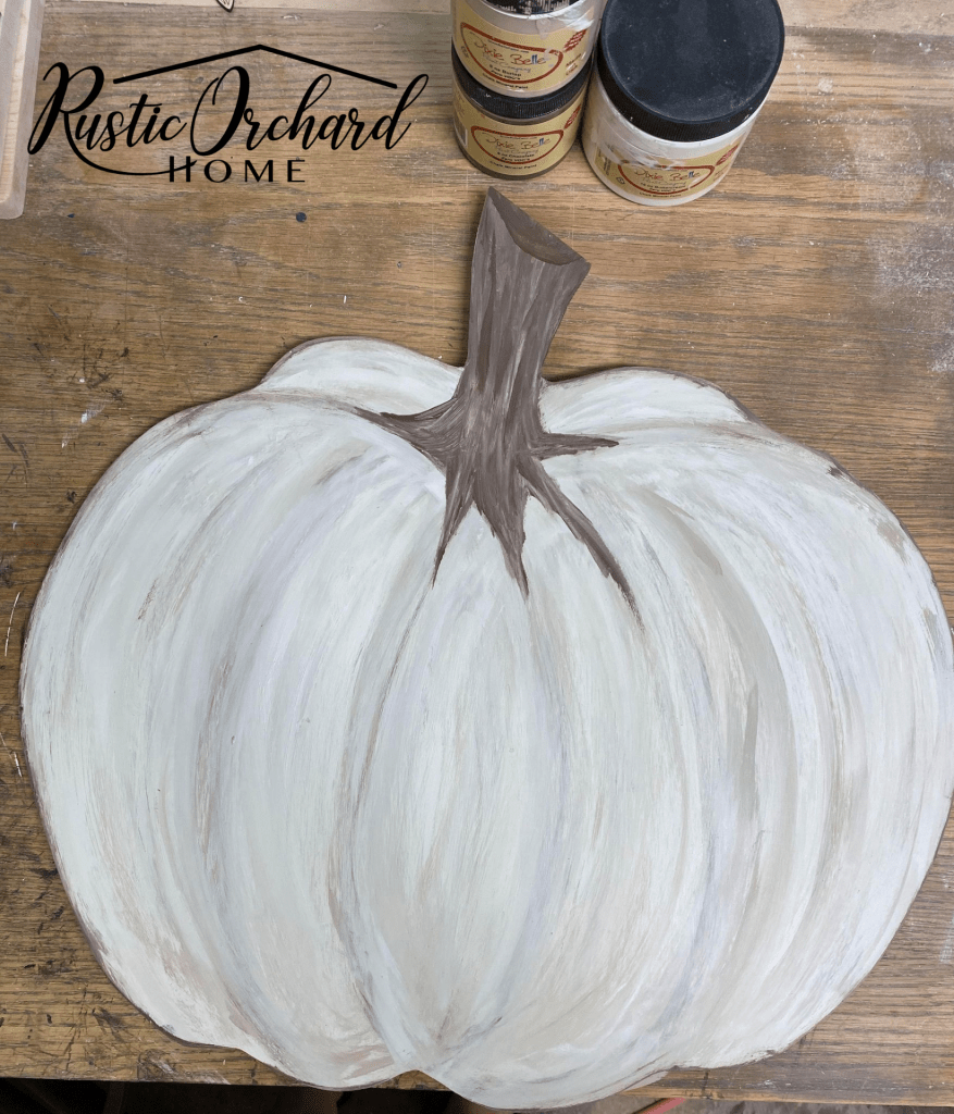 This painted wood pumpkin cutout tutorial is perfect for those who love fall and want to add a seasonal element to their home decor.
