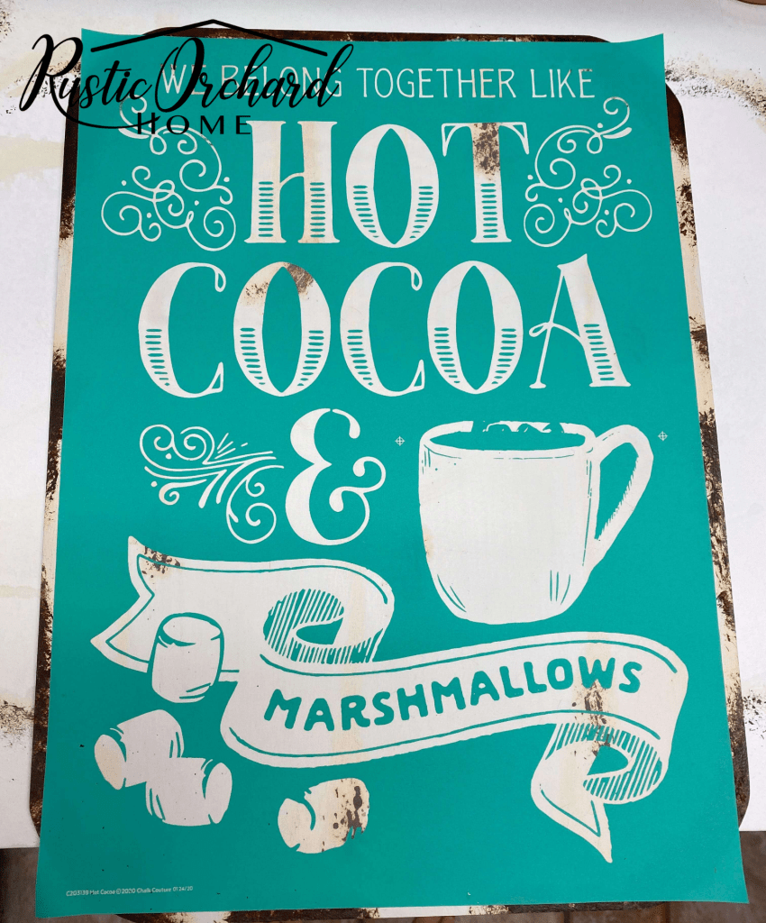 This DIY Hot Cocoa Sign has a vintage Christmas feel thanks to a patina paint finish. Learn how to make one for your home this season.