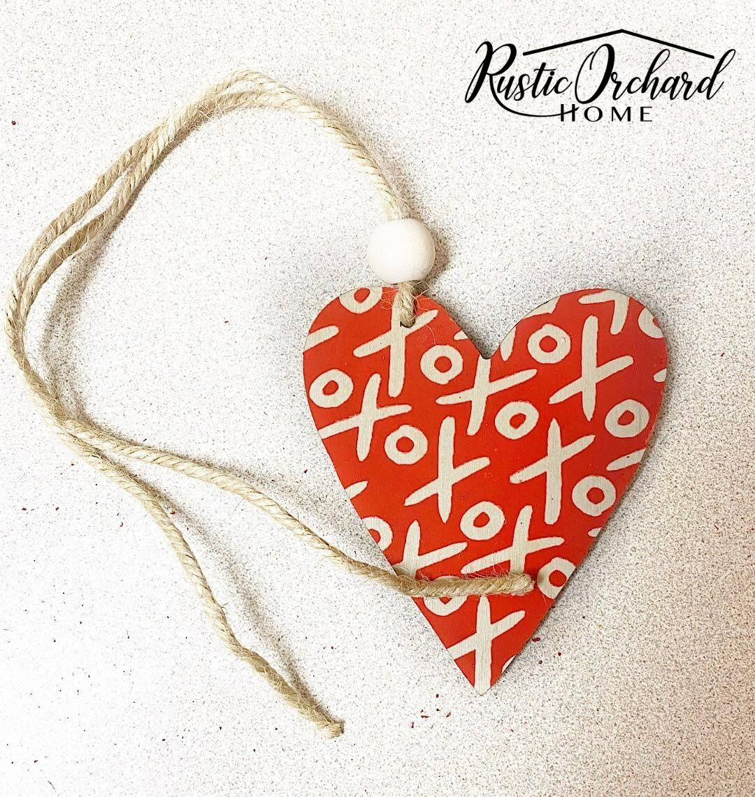 Make your own DIY Wooden Valentine's Day Tag! This tutorial features a heart shaped tag with stenciled details and wood beads.